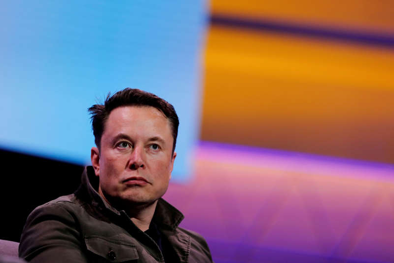 Elon Musk looking at the camera: FILE PHOTO: SpaceX owner and Tesla CEO Elon Musk speaks during a conversation with legendary game designer Todd Howard at the E3 gaming convention in Los Angeles