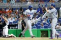 Puig confronts Marlins pitcher after nearly being hit