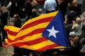 Judge orders 9 Catalan leaders to be held in custody pending trial