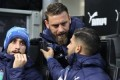 Low hails De Rossi's angry response as moment of 'greatness'