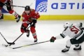 Kane, Crawford lead Blackhawks past Wild for 5th straight