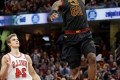 James helps Cavs down Bulls