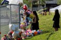 Couple charged with stealing from Parkland shooting memorial