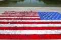 Visitors build giant American flag out of LEGO bricks on National Mall
