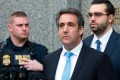 Michael Cohen drops Trump link on bio