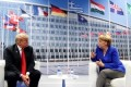 Trump, Merkel meet at NATO after he slams Germany