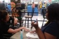 When a woman with cerebral palsy was denied a manicure, this cashier stepped in