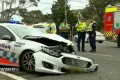 Woman critical after police car hits Mercedes