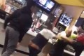 The shocking moment a group of men punch, kick and wrestle each other to the ground inside a McDonald's in front of terrified customers