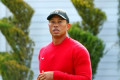 Tiger Woods breaks tradition for Phil Mickelson match, wears red on a Friday