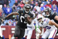 Jaguars RB Leonard Fournette suspended 1 game for punching Bills DE Shaq Lawson