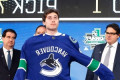 Canucks considered asking Quinn Hughes to join them this season