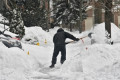 Woman charged after snow-shovel fight