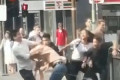 Moment a huge brawl that started outside a busy pub spills onto one of the busiest roads in Melbourne and leaves commuters stunned