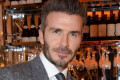 David Beckham faces being hauled into court 'after CCTV emerges of him using a mobile phone behind the wheel' - weeks after a speeding charge was dismissed on a technicality