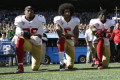 Colin Kaepernick, Eric Reid resolve grievances with NFL