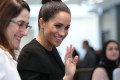 Meghan Markle backs campaign to 'decolonise the curriculum' by adding more black women to university staff instead of 'male, pale, and stale' professors in her first political intervention since joining the royal family