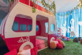 Hotel suite transformed into Barbie-themed glamping experience