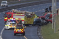 Horror five-car motorway crash leaves one dead and 11 injured