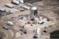 EXCLUSIVE: Elon Musk's Starhopper prototype gleams on the launchpad in stunning aerial photos ahead of its first test hop
