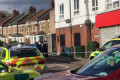 Man 'armed with machete' held over unexplained death