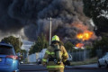 Arson squad to probe warehouse blaze after fireys finally put it out
