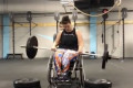 Cancer survivor with cerebral palsy now a CrossFit trainer