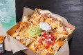 Taco Bell's New $5 Grande Nachos Box Comes With A Double Serving Of Meat And Guac