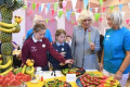 Charles and Camilla join in community lunch