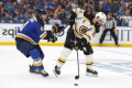 The Latest: Bruins grab 1-0 lead on Blues in Game 3
