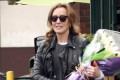 Felicity Huffman Is All Smiles with Flowers Ahead of Daughter Sofia's Graduation
