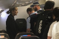Chaos on a Qantas flight from Bali to Sydney as a woman barricades herself inside the plane's bathroom – before flight attendants tear down the door and arrest her