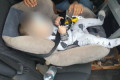 Driver fined over this bizarre baby seat set-up