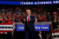 President Trump unveils 2020 slogan to replace 2016 rallying cry during campaign rally