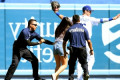 Fan runs onto field during Dodgers game to hug Cody Bellinger