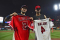 Pujols, Molina trade jerseys in emotional embrace
