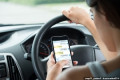 The $1,000 phone call: Drivers to be slapped with record fines for using their mobiles behind the wheel