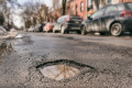 Councils need £10 billion to solve 'national scandal' of Britain's potholes but there's no cash