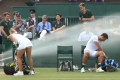 Rogue sprinkler causes chaos at Wimbledon, forcing mixed doubles match to move