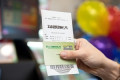 Powerball frenzy: One in three Australian adults expected to buy a ticket for the $80 million jackpot draw