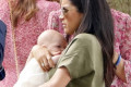 'She doesn't know how to carry her own baby': Meghan Markle is mom-shamed on Instagram by critics claiming she looks like she is about to DROP newborn Archie in photos from their first public outing