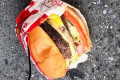 'It looked like it had come off the grill like five minutes ago': Mystery as wrapped In-N-Out burger is found on NYC street yet the restaurant is more than 1,500 miles away