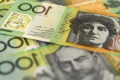 Australian dollar slumps to 10-year low after New Zealand central bank rate cut