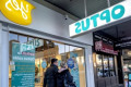 Optus profits drop by almost a third