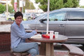 EXCLUSIVE: Ghislaine Maxwell STAGED In-N-Out photo in Los Angeles with her close friend and attorney, using confidante's dog Dexter in the snapshot