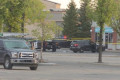 Man charged after officer-involved shooting at southeast Calgary shopping complex