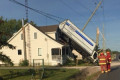 Cargo truck lands on roof of house, Scarborough man charged: OPP