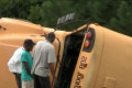 Driver killed, 8 students injured in school bus crash