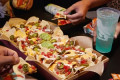 Taco Bell Makes A Giant Vat Of Nachos For Less Than $8