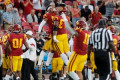 Bill Plaschke: On improbable night, Trojans live up to their motto and silence critics